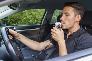 image of driver taking breathalyzer test